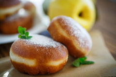 Donuts with quince filling sprinkled Royalty Free Stock Images