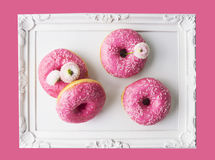 Donuts in romantic white frame, isolated Royalty Free Stock Image