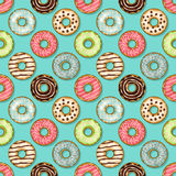 Donuts seamless pattern on blue background Royalty Free Stock Image