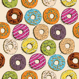 Donuts seamless pattern in doodle design. Cartoon style. Vintage. Stock Image