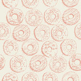 Donuts seamless pattern in doodle design. Cartoon style. Vintage. Stock Photo