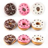 Donuts set isolated on white background. Different type of donuts: with chocolate, with pink and vanilla cream. Top view stock image