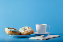 Donuts with sketchbook Royalty Free Stock Photography