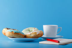 Donuts with sketchbook Royalty Free Stock Photos