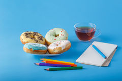 Donuts with sketchbook and color pens Royalty Free Stock Images