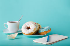 Donuts with sketchbook Stock Photography