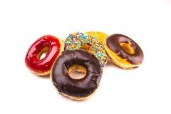 Donuts som isoleras på vitbakgrund Royaltyfri Bild