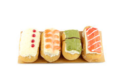 Donuts sort in the  bamboo dish. Royalty Free Stock Photography