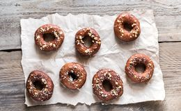 Donuts sprinkled with crushed nuts Stock Images