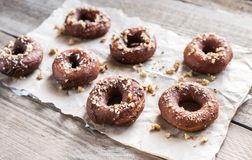 Donuts sprinkled with crushed nuts Stock Photos