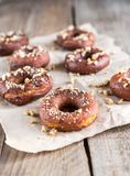Donuts sprinkled with crushed nuts Royalty Free Stock Image