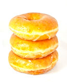 Donuts stacking on white background Royalty Free Stock Photography