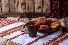 Donuts and stewed fruit. On the embroidered towel Ukrainian-style donuts and stewed fruit Stock Photography