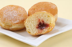 Donuts with strawberry jam royalty free stock images