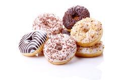 Donuts stuffed. With chocolate, hazelnut, vanilla on white background Stock Photography