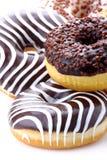 Donuts stuffed. With chocolate, hazelnut, vanilla on white background Royalty Free Stock Photos