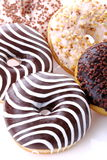 Donuts stuffed. With chocolate, hazelnut, vanilla on white background Stock Image