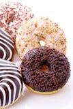 Donuts stuffed. With chocolate, hazelnut, vanilla on white background Royalty Free Stock Photo