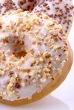Donuts stuffed. With chocolate, hazelnut, vanilla on white background Stock Photo