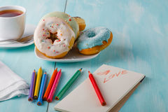 Donuts on table with sketchbook Stock Photo