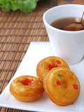 donuts with tea in background Royalty Free Stock Image