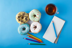 Donuts with tea Royalty Free Stock Photos