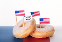 Donuts with Thank You Sign. Four Donuts with American Flags and a Thank You Flag Royalty Free Stock Image