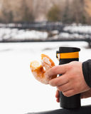 Donuts thermos outdoors Stock Image