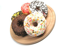 Donuts tilted. Some freshly baked donuts on plate Stock Images