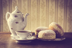 Donuts on tray with cup of coffee in old-fashioned Stock Photos