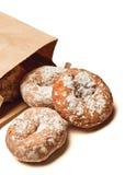 3 donuts uit een zak Royalty-vrije Stock Foto