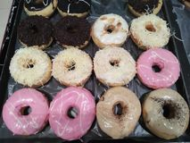 Donuts with various color flavors and pleasures royalty free stock images