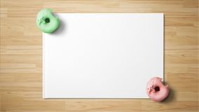 Donuts on white paper on wooden background royalty free stock images