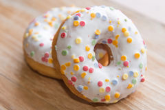 Donuts on wooden background Royalty Free Stock Photo