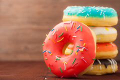 Donuts on a wooden background. Junk food. Fast food. Royalty Free Stock Image