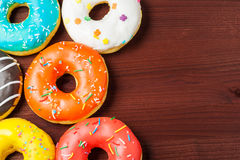 Donuts on a wooden background. Junk food. Fast food. Donuts on a wooden background. Junk food. Fast food Stock Photos