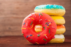 Donuts on a wooden background. Junk food. Fast food. Donuts on a wooden background. Junk food. Fast food Stock Photography