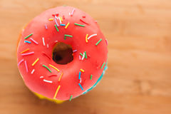 Donuts on a wooden background. Junk food. Fast food. Stock Photo