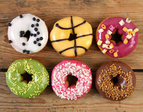 Donuts on wooden background Stock Photos