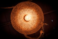 Donuts wooden style light bulbs hang under the house roof. royalty free stock images