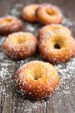 Donuts on wooden table Royalty Free Stock Image
