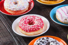 Donuts on wooden table. Royalty Free Stock Photo