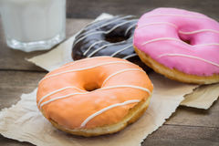 Donuts on wooden table Royalty Free Stock Photography