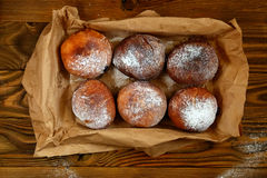 Donuts on a wooden tray on wood background Royalty Free Stock Photos