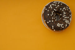 Donuts on a yellow background Royalty Free Stock Image