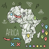 Doodle Africa map on green chalkboard with pins Stock Images