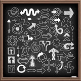 Doodle arrow symbols set. On black chalk board. Line art style icons for web site, mobile app, infographics. Hand drawn graphic design elements. Movement Royalty Free Stock Images