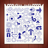 Doodle arrow symbols set. Graphic design elements hand drawn with blue pen on note paper. Line art style icons for web site, mobile app, infographics Royalty Free Stock Photography