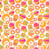 Doodle .Bakery,Cakes and dessert,pastries ,lettering seamless pattern.Colored vintage icons,sweet elements background. Royalty Free Stock Image