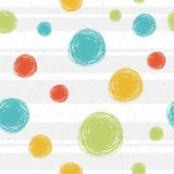 Doodle blue green yellow circles seamless pattern on background with stripes, abstract background vector. Printing on. Fabric, wallpaper, girlish royalty free illustration